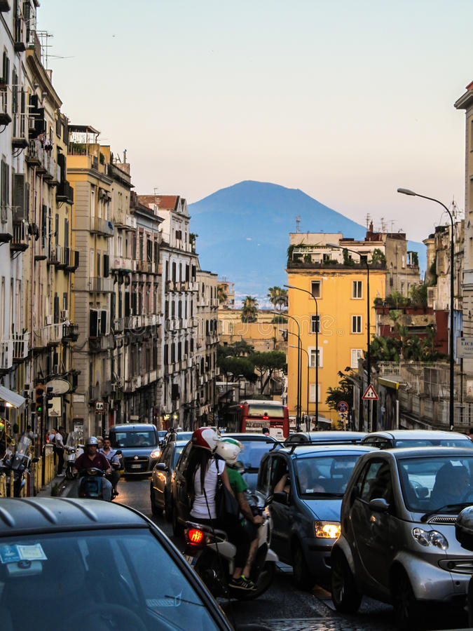 Hectic traffic in Naples - Mount Vesuvius in the background. NAPLES, ITALY - CIRCA JUNE 2015: Hectic traffic in Naples - Mount Vesuvius in the background royalty free stock photos