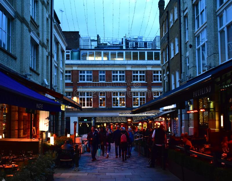 David Bowies Ziggy Stardust album cover location at night. Heddon Street, London, United Kingdom. Heddon Street, London, UK. David Bowies Ziggy Stardust cover stock photos