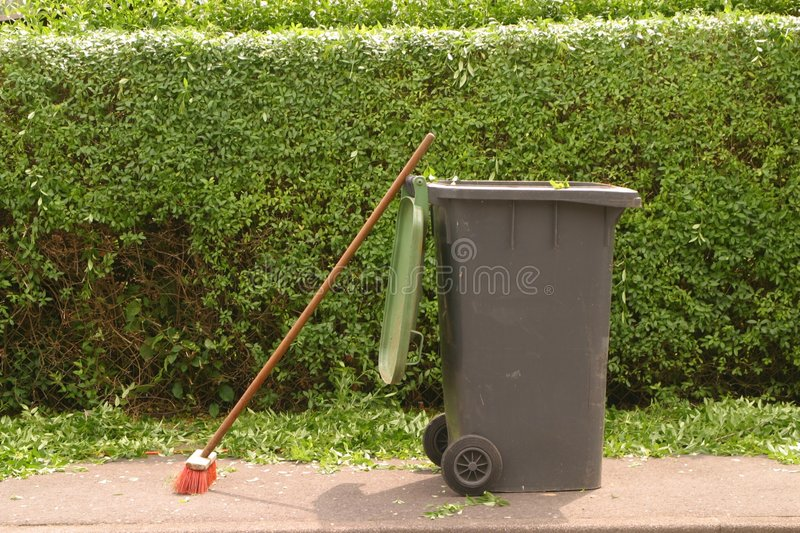 Hedge cleaning. Cleaning work on hedge stock photo