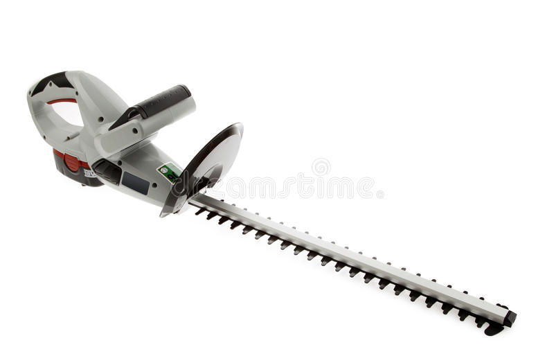 Hedge trimmer. New cordless hedge trimmer isolated on plain background royalty free stock photos