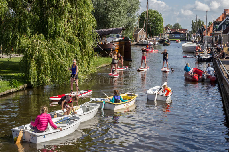 HEEG, NETHERLANDS, June 27, 2015: The lively old harbor of Heeg royalty free stock image