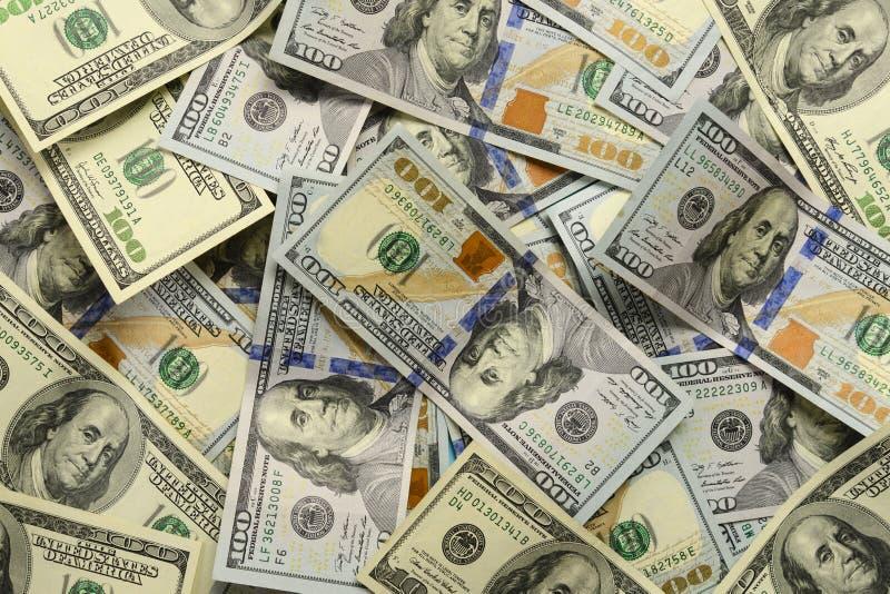 Heel wat 100 dollarrekeningen van Amerikaanse dollars als achtergrond stock fotografie