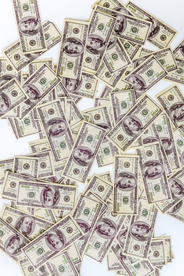 heel wat dollarsbankbiljetten op een witte achtergrond, hoogste mening stock fotografie
