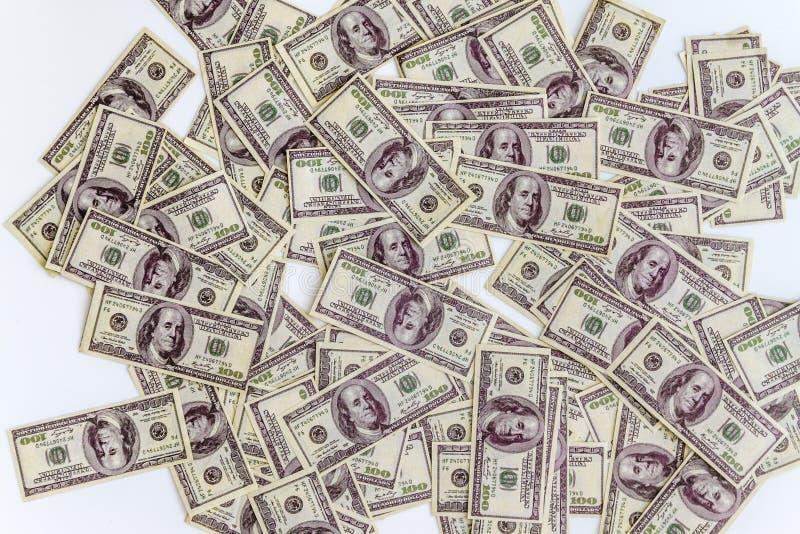 heel wat dollarsbankbiljetten op een witte achtergrond, hoogste mening stock afbeeldingen