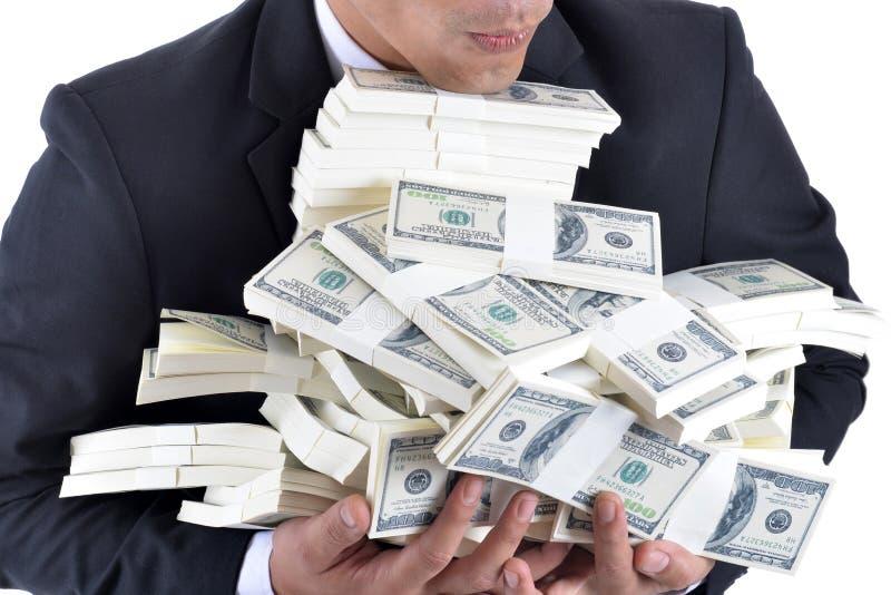 Heel wat geld in de handen van een jonge zakenman stock afbeelding