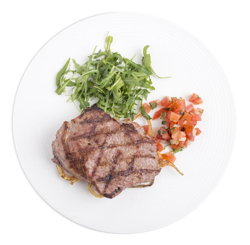Heerlijk marmerlapje vlees in een witte plaat royalty-vrije stock fotografie