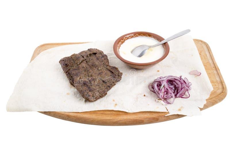 Heerlijk rundvleeslapje vlees met saus stock foto
