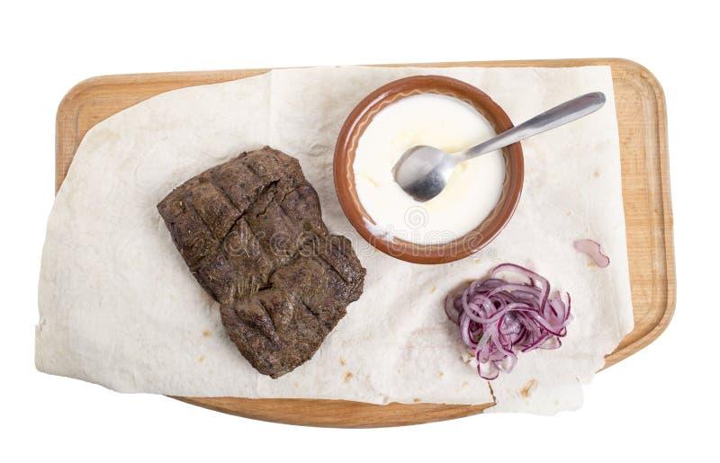 Heerlijk rundvleeslapje vlees met saus stock fotografie