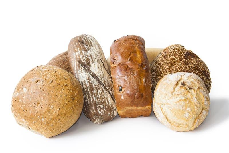 Heerlijk vers gebakken die brood op witte achtergrond wordt ge?soleerd stock foto's