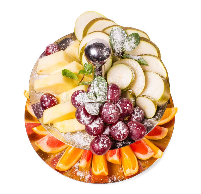 Heerlijke gesneden vruchten als dessertschotel stock fotografie
