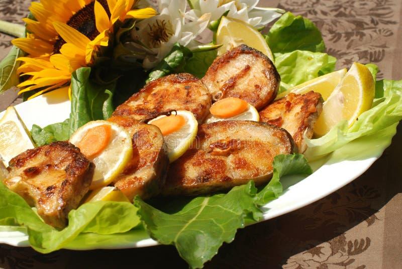 Heerlijke katvis escalope stock afbeeldingen