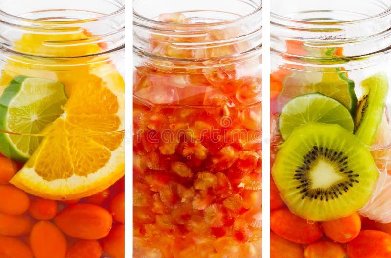 Heerlijke verfrissende drank van mengelingsvruchten trillende verticale strepen, infusiewater royalty-vrije stock foto's