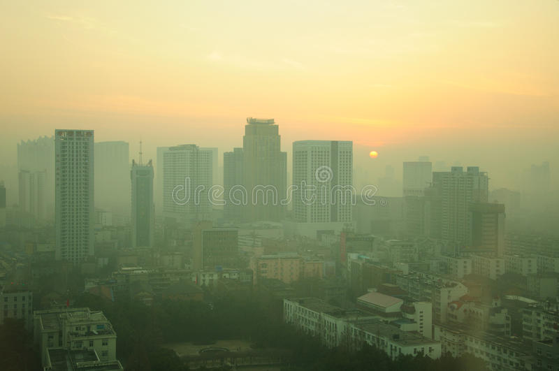 Hefei China Early Morning. The early morning sunrise coming up over the polluted skyline of Hefei, China located in Anhui Province royalty free stock photo