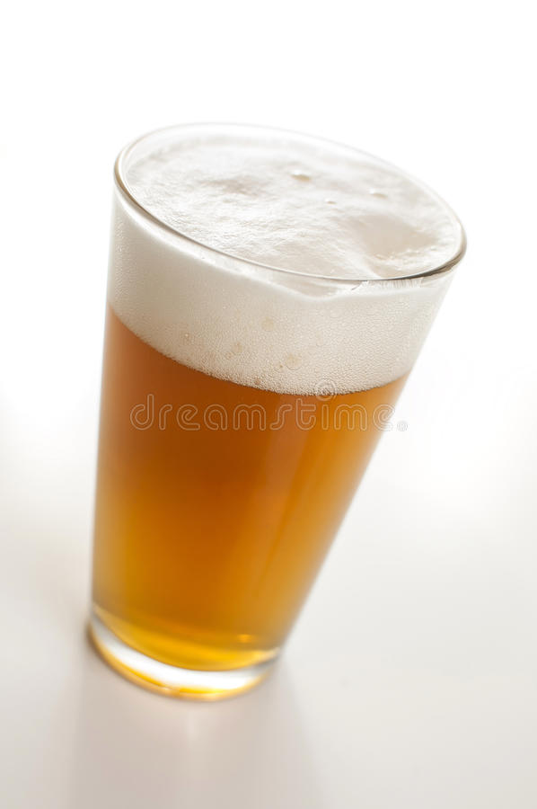 Hefeweisen beer in a beer glass. Fresh pint of Hefeweisen in a beer glass royalty free stock photos