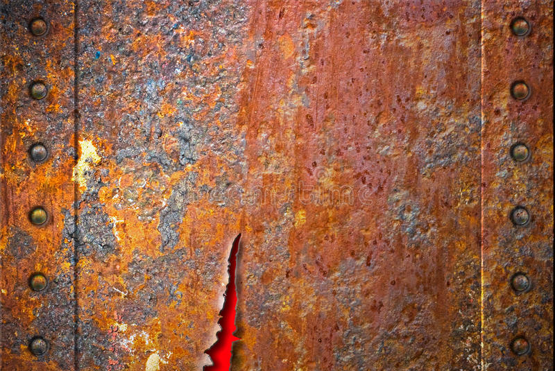 Heftige rostige Metallbeschaffenheit mit Nieten stockfotos