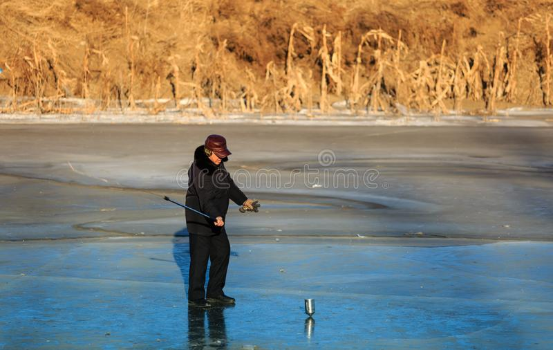 Hegang city,China-21 JAN 2019:Spinning top on ice on frozen river during winter stock photo