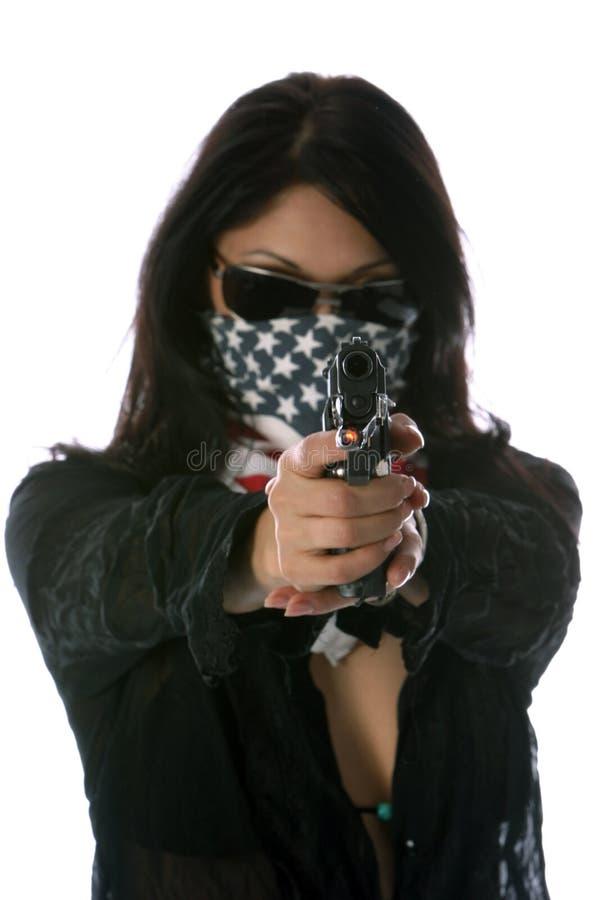 Heiße Mädchen mit Gewehr-Konzepten lizenzfreie stockfotos