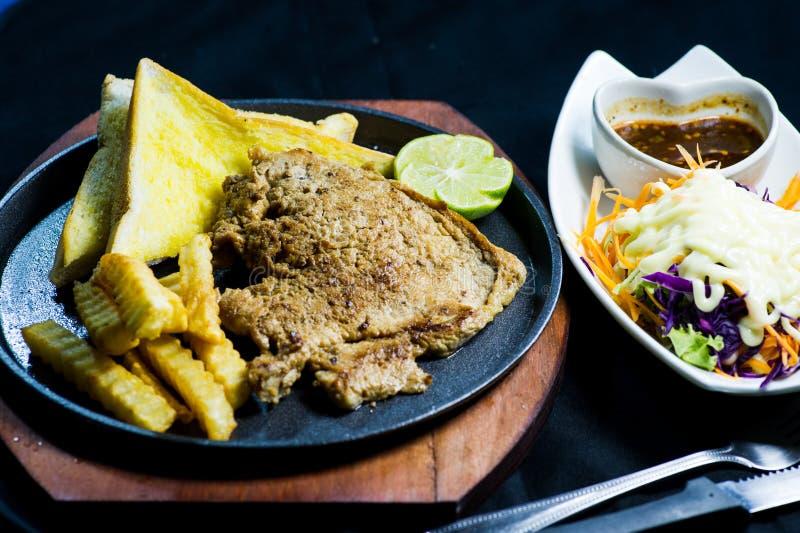 Heiße Wanne des Schweinefleisch-Steaks lizenzfreies stockfoto
