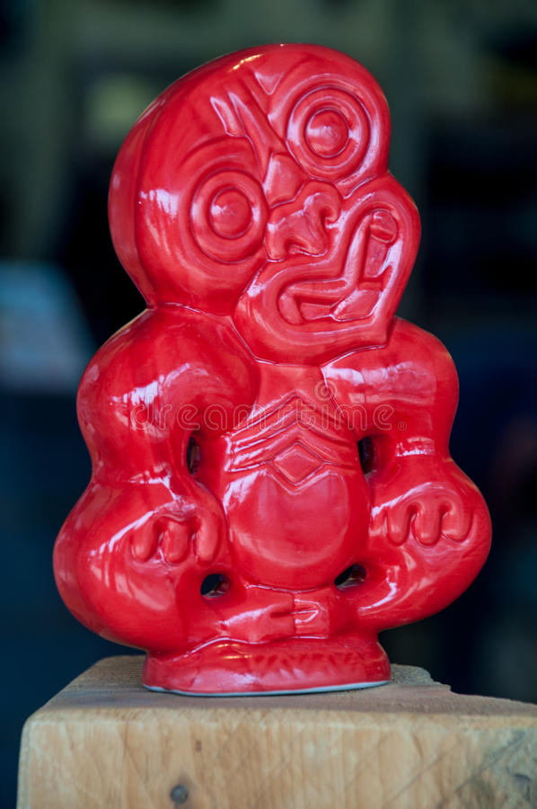 Hei Tiki. The hei-tiki is an ornamental pendant of the Maori.. Hei-tiki are usually made of pounamu (greenstone) and worn around the neck. For many Maori the royalty free stock photography