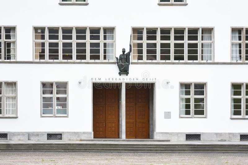 Front of main building of Ruprecht-Karls-University with statue of Roman goddess of wisdom Minerva above enterance royalty free stock images