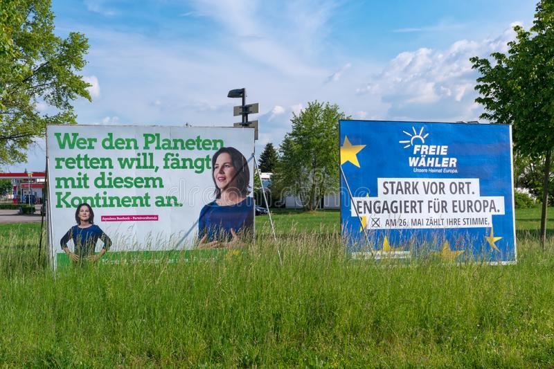 The Election campaign billboards of the German political party The Greens and of the association of Free Voters. Heidelberg, Germany - May 19 2019: The Election stock photography