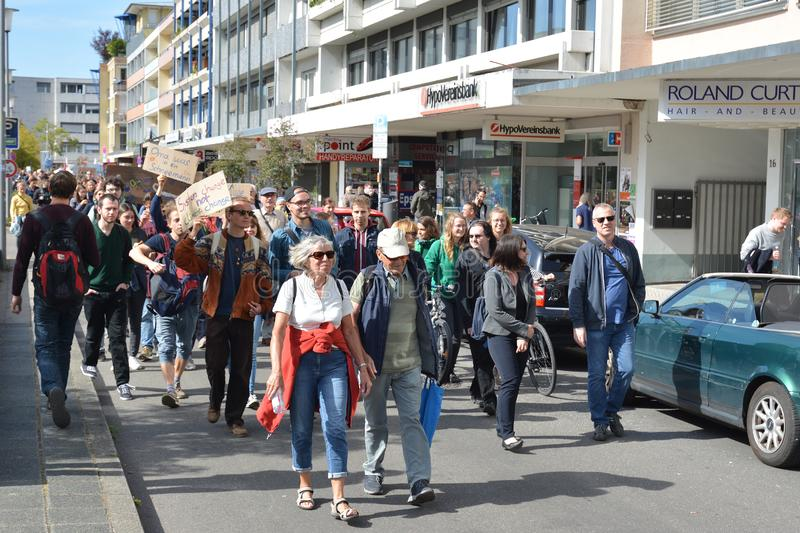 Demonstrants led by an elderly couple marching with protest signs during Global Climate Strike event stock photo