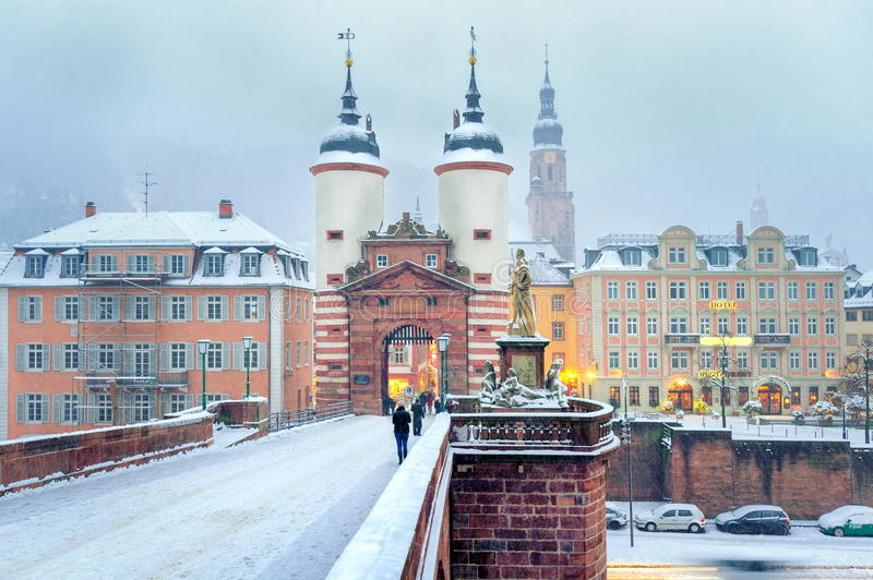 Heidelberg, Germany. In winter. View over the bridge to town gates stock images