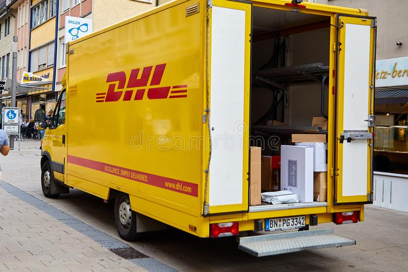 Heilbronn, Germany - August 9, 2019: Car with the DHL logo. Unloading goods. DHL - an international company for the fast delivery stock images