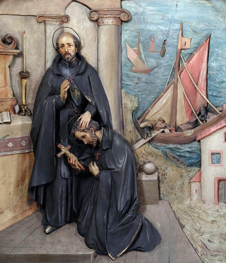 Heilige Ignatius stuurt Heilige Francis Xavier in de opdracht stock afbeelding