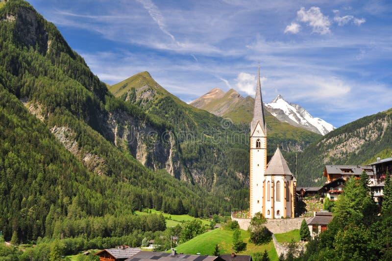 Heiligenblut church in front of Grossglockner peak stock photos