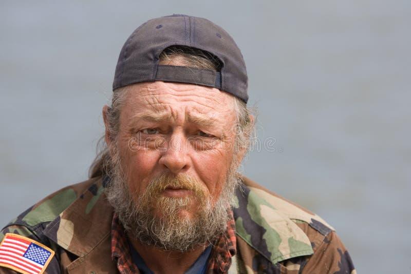 Heimatloser alter Mann stockbild