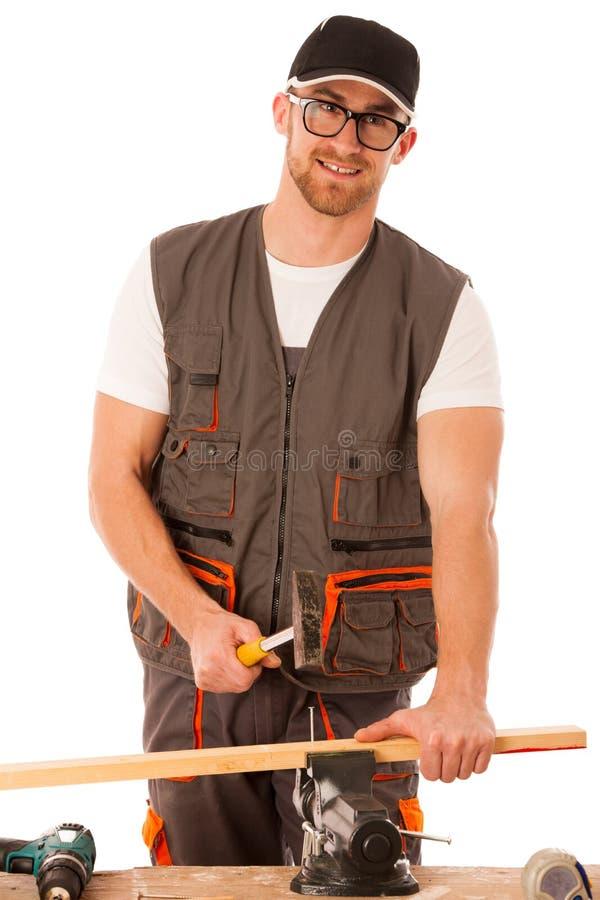 Heimwerker in der Arbeitskleidung, die Nagel mit Hammer im Haupt-wor hämmert stockbild