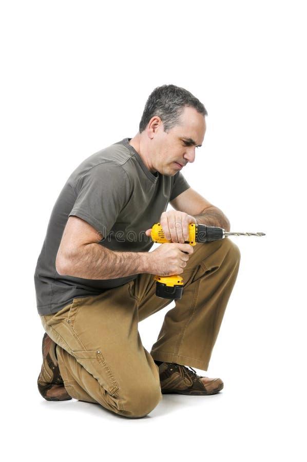 Heimwerker mit einem Bohrgerät lizenzfreies stockbild