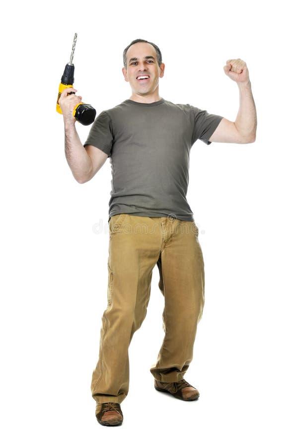 Heimwerker mit einem Bohrgerät stockbilder
