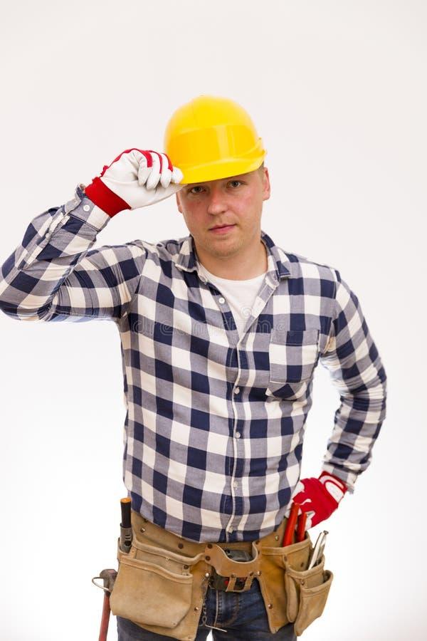 Heimwerker mit einem Werkzeuggurt Kopieren Sie Raum lizenzfreie stockfotos