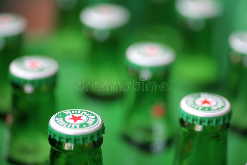 Heineken beer. Bucharest, Romania - July 26, 2011: Close-up shot of a Heineken beer bottle caps. Heineken is a Dutch beer which has been brewed by Heineken