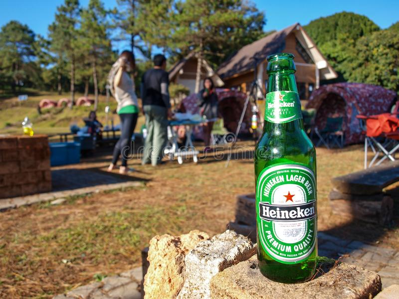 THe Heineken beer in the trip. The heineken beer at the traveling trip to camping in the forest royalty free stock photography