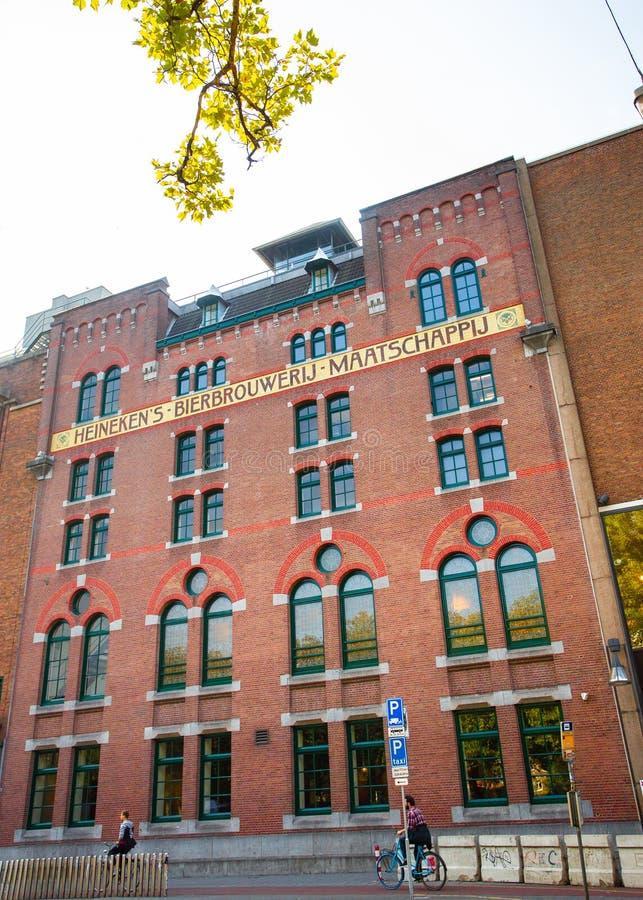 Heineken Brewery Headquarters in Amsterdam. AMSTERDAM, NETHERLANDS - SEPTEMBER 2, 2018: Exterior view of historic Heineken Brewery Headquarters in Amsterdam stock photography