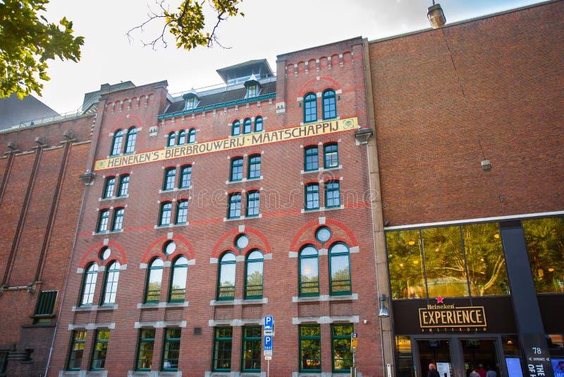 Heineken Brewery Headquarters in Amsterdam. AMSTERDAM, NETHERLANDS - SEPTEMBER 2, 2018: Exterior view of historic Heineken Brewery Headquarters in Amsterdam stock photos