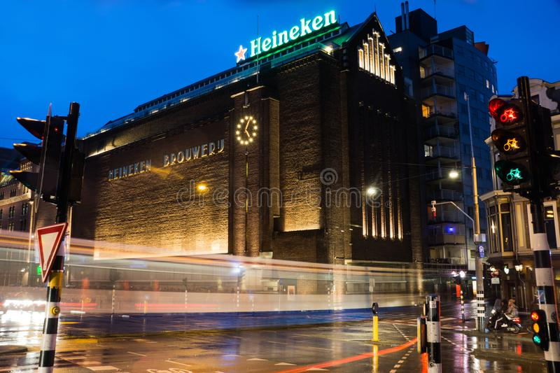 The Heineken experience in Amsterdam, The Netherlands. A night shot of the busy street scene outside the Heineken Experience in Amsterdam, The Netherlands stock image