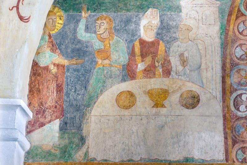 Heirat bei Cana, ein altes Romanesquefresko in einem dänischen churc stockfotografie