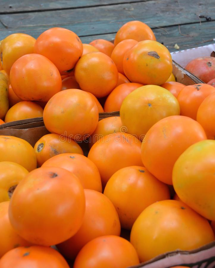 Heirloom Orange Tomatoes. For sale at the outdoor farm market stock photos
