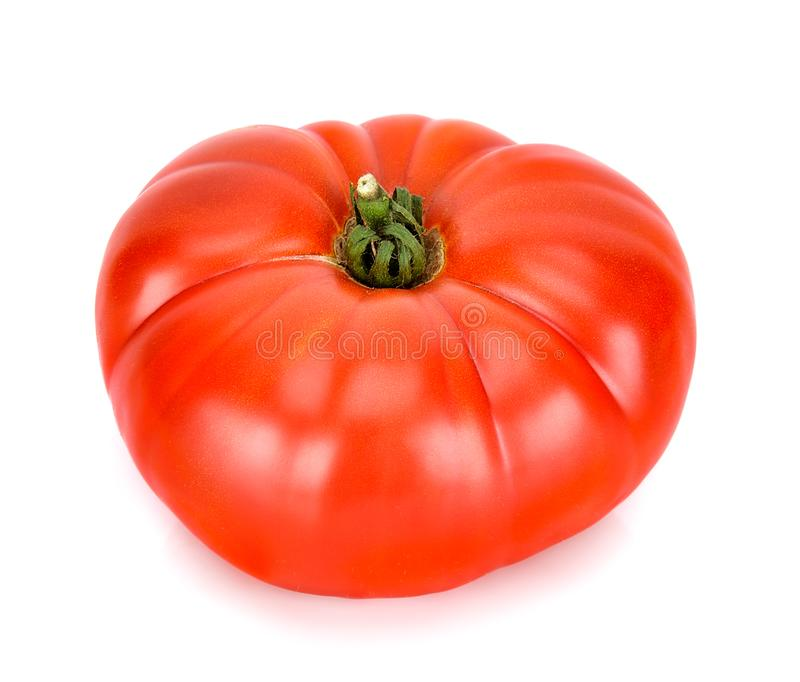 Heirloom tomato isolated on the white background stock photos