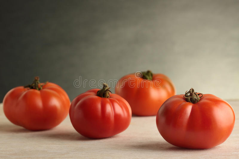Heirloom Tomatoes. Four fresh, organically grown Heirloom tomatoes stock image