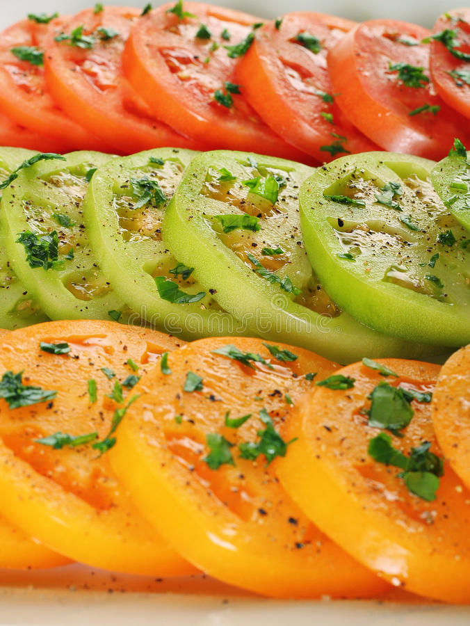 Heirloom tomatoes closeup. Shot of heirloom tomatoes closeup royalty free stock photo