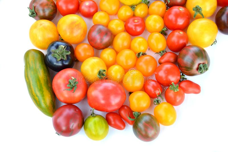Heirloom tomatoes. Heirloom colorful tomatoes on white background stock photo