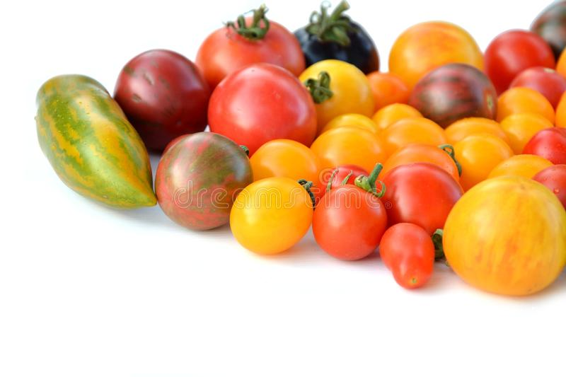 Heirloom tomatoes. Heirloom colorful tomatoes on white background royalty free stock images