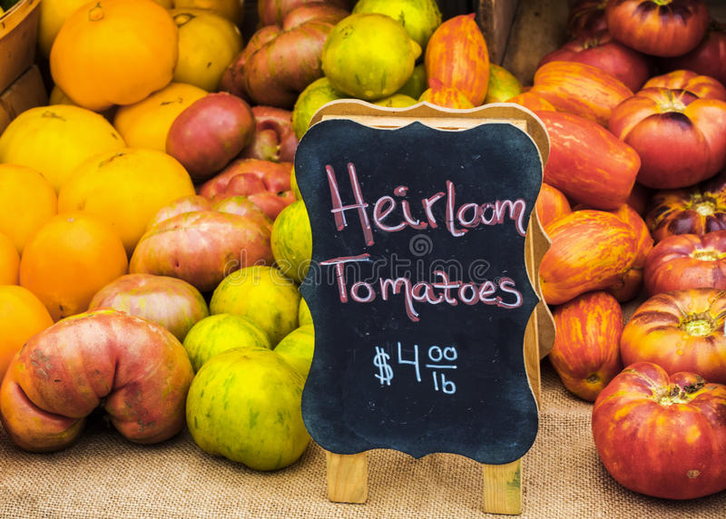 Heirloom Tomatoes. Several varieties of heirloom tomatoes for sale at farm market stock images