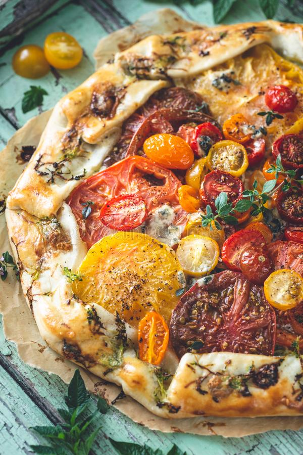 Heirloom Tomatoes Tart with Fresh Tomatoes and Cheese stock image