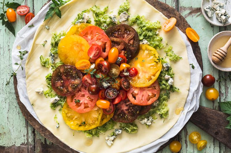 Heirloom Tomatoes Tart with Zucchini, Blue Cheese, Thyme and Honey. On Wood Background royalty free stock photography